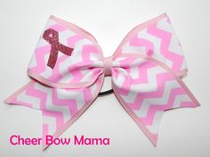 This bow is made of pink and white chevron fabric on a 3-inch pink grosgrain ribbon with a pink glitter Breast Cancer Awareness Ribbon on the loop.