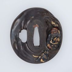 Tsuba with design of Ushiwakamaru and the Tengu King. Edo period early to mid-19th century - Hamano Shôzui (Japanese, 1696–1769) http://www.mfa.org/collections/object/tsuba-with-design-of-ushiwakamaru-and-the-tengu-king-12176
