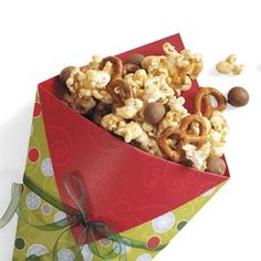 just gonna throw together microwave popcorn, choc. covered pretzels, and peanut m  Maybe some yogurt raisins Easy