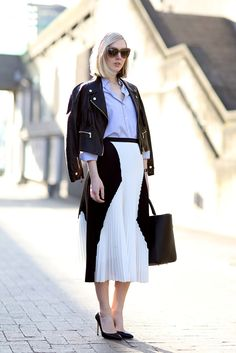 """I love everything about this: graphic midi skirt, kinda preppy blue blouse, cropped leather biker jacket, retro shoes and glasses ... If someone said, """"what is your ideal style day?"""" this would be it. :) 70 Amazing London Street-Style Snaps #refinery29"""
