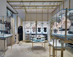Luxury golden steel lingerie shop interior design with manufacture Lingerie Store Design, Milan Boutique, Retail Interior Design, Retail Fixtures, Underwear Shop, Bra Shop, Luxury Decor, Retail Space, Boutique Design