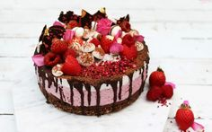 <p>Pinks, reds, and chocolate create a romantic display in this elegant raspberry cheesecake.</p>