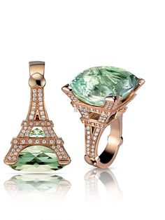 I'm not a fan of the gold or the green jewel really, but this is so cool otherwise! :) Eiffel Tower ring :)