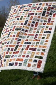 """We could use this pattern. Each """"block"""" is one rectangle and two smaller squares. We could replace some of these """"blocks"""" with a photo and leave some that would have wished written on rectangle and smaller squares. Batik Quilts, Scrappy Quilts, Stained Glass Quilt, Charm Quilt, Green Quilt, Quilt Top, Square Quilt, Quilting Designs, Quilt Blocks"""