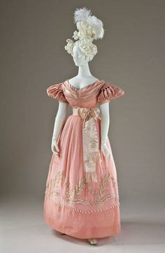 Pink silk gown from the 1830s. The skirt is decorated with a sea of faux pearls which weigh down the sheer silk and would click together lightly as its wearer moved. http://trouvaillesdujour.blogspot.com/…/fashion-chic-europe…