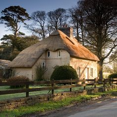 Thatched cottage at Merthyr Mawr / thatch / thatched roof / historic / house exterior /