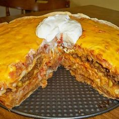 Mexican tortilla casserole--Ingredients: ground beef cup diced onion… 1 pack taco seasoning mix 2 cups shredded cheddar cheese 1 can refried beans (they spread easier if you warm them in microwave) 1 cup prepared rice (I used Minute Rice) 1 can Mexican Yummy Recipes, Beef Recipes, Great Recipes, Cooking Recipes, Yummy Food, Favorite Recipes, Healthy Recipes, Cooking Chef, Cooking Steak