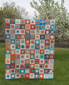 Tealorange finished. Collaborative quilt using teal, orange, and cream. Measured and liberated piecing. Quilted using straight lines.
