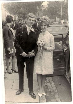 A 1966 bride and groom on their wedding day. Too cute!