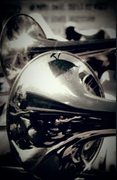 take both trombones and then have his reflection in the bell - do black & white photography.