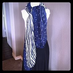 """Two Navy and Cream Scarves/Wraps In One! Huge rectangular wrap. Can be worn so many ways - either all anchors, all stripes, or a mixture of both. Lightweight - perfect for cooler weather in spring or summer. No tags, but I don't think this has ever been worn. 100% Polyester. Approximate measurements:    Width- 39.5"""" Length - 75"""" Accessories Scarves & Wraps"""