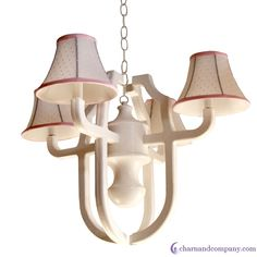 """The Carolyn chandelier is sweet and stylish with a lantern inspired wooden frame and paired with beautiful white swiss dot shades for a truly unique fine.Exclusive wooden armed chandelier21"""" diameter x 17"""" heightIncludes 3 feet of chainselect chain and canopy color to matchIncludes soft lined custom shadesflame retardant lining"""