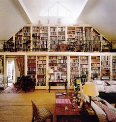 I love books and wouldn't it be fun to live in a loft with all these books?!