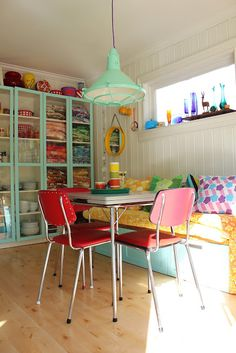 Cute craft room with chrome table.