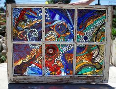 old windows...into mosaics.  I love this...now, to find some windows.
