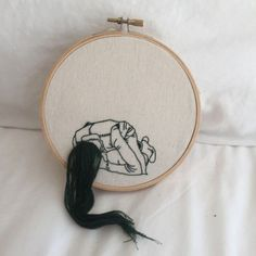Sheena Liam's embroidery art. I love the use of a simple embroidery hoop and simple colour choices that contrast with the 3D effect created by the hair. It is a unique view and works very well