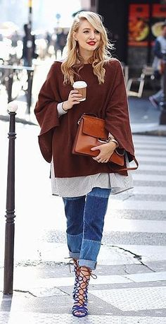 Play with proportions, like an oversize shirt that's longer than your sweater