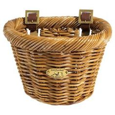 Rattan bicycle basket with adjustable leather straps that attach to handlebars.  Product: Bicycle basketConstruction Material: Rattan and leatherColor: HoneyFeatures: Thick woven rattan weathers nicely over timeDimensions: 8.75 H x 11.5 W
