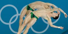 Germany's Patrick Hausding and Sascha Klein compete in the men's synchronised 10m platform final diving event at the London 2012 Olympic Games at the Olympic Park in London on July 30, 2012. AFP PHOTO / LEON NEAL (Photo credit should read LEON NEAL/AFP/GettyImages)