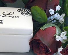 Ceramic Live keepsake box by GrapeVineCeramicsGft on Etsy. It's great for small trinkets and jewlery. $15
