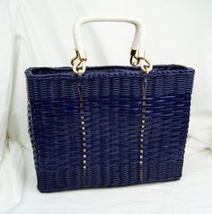 Hey, I found this really awesome Etsy listing at https://www.etsy.com/listing/201546036/vintage-1960s-blue-wicker-tote-purse