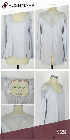 "Free People long sleeve top Sz M. Free People long sleeve top. Scoopneck. Features mesh cutout shapes on shoulders and back.  Hangs longer in the back with a split hem. Rayon/polyester. Gently used, no flaws. Approx measurements Bust 42"" Length 26""-28"". Free People Tops Tees - Long Sleeve"