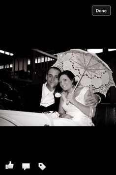 Vintage car with bride and groom, and parasol