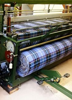 Isle of Man Tartan on Loom. Incorporating the blue of the sky, the green of the fields and the purple Manx Heather