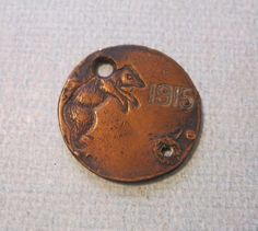 Antique PPIE 1915 Bear Spinner Coin Token by Suite22 on Etsy, $20.00