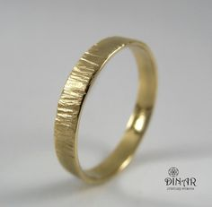 This beautiful Hammered textured 14k yellow gold wedding ring, was chiseled handmade by special hammering technique , which created a special tree trunk texture .  Designed for men and women.