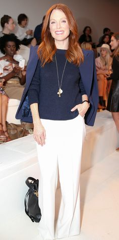 Julianne Moore attended the Ralph Lauren Spring/Summer 2015 show in New York where the designer showed a collection full of cargo pants, khakis, metallic organza gowns, and glittery beaded tops.