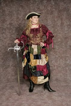 $30.00 Costume Rental  Pirate Ruth  multi texture patchwork skirt, maroon blouse w/ribbon details, gold & maroon bodice
