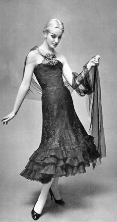 Barbara Cailleux in black lace dance dress with tulle panel worn as stole by Chanel, photo by Georges Saad, 1956