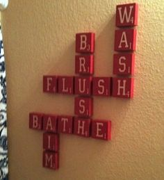 Scrabble board message artwork for the bathroom. Cute Idea. I'm thinking larger homemade tiles though.