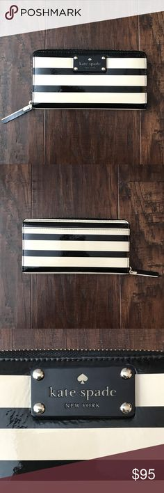 kate spade wallet kate spade black and white stripes wallet zip around with 12 slots and interior zipper! Has never been used! Will negotiate price!! kate spade Bags Wallets