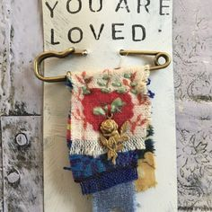 A gift for someone you love to remind them of of your love & gratitude. Or perhaps it is a gift to your self as a reminder of gentle self love. Created from vintage fabrics, hand stitched on t… Safety Pin Jewelry, Magic Charms, Brooch Corsage, Fabric Brooch, Make Do And Mend, Rustic Crafts, Textiles, Bijoux Diy, Fabric Jewelry