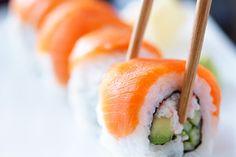 eating salmon sushi rolls