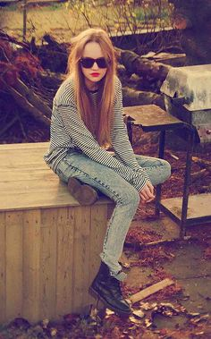 Street style fashion : black sunnies, striped top, acid wash jeans & boots. Love this grunge look