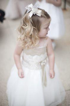 Fancy flower girl with bows in her hair: http://www.stylemepretty.com/2014/09/30/bohemian-chic-chicago-wedding/ | Photography: Lauren Balingit - http://laurenalbanese.com/