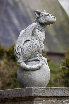 Eryl Mythical Garden Statue   The dragon winged garden statue Eryl is pearched on a finial and looking to keep watch over your home. Eryl can be placed along side of fellow protector Oscar and you will have the perfect match of mythical garden statues. Eryl comes in 12 finishes and ships for free.