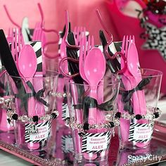 i like the idea of having the cup and silverware all together like a party favor...