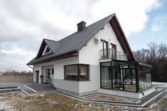 Polish architects Biuro Projektowe MTM STYL have taken a classic family home and turned it into the sweetest little space that you'll ever find. Double Storey House, Hotel Lounge, Dream House Exterior, Facade House, Cottage Homes, Simple House, Modern House Design, Home Fashion, My Dream Home
