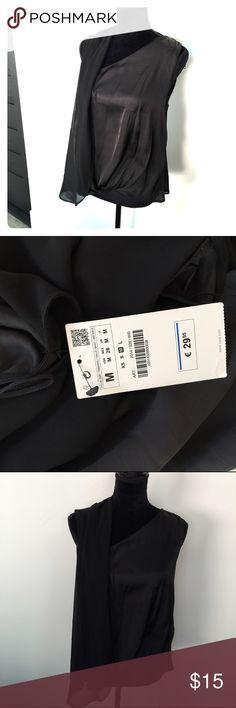 Zara black top Very feminine and chic Zara black sleeve less blouse.  Nwt size medium. Zara Tops Blouses