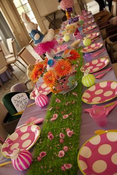 Love the green grass table runner.  Stuffed Rabbit for center piece and polkadot plates
