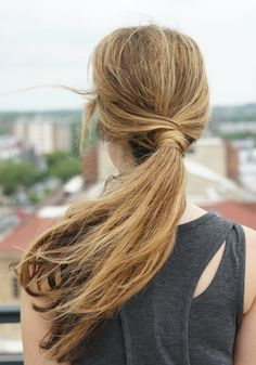 Step by step (with photos for each step) instructions on a messy wraparound ponytail