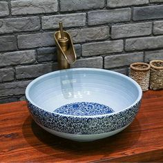 Faucet Mount: No Hole Processing: Grinding Type: Bowl Sinks / Vessel Basins Material: Ceramic Basin Shape: Round Capacity: 12L Special Application: Bathroom Sink Diameter: 40-42cm Height: 14-16cm