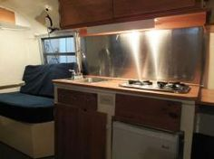 Knotty pine boler, stainless steel kitchen.