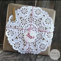 Kraft paper, bakers twine, doily, chipboard letter, and gift tag!!