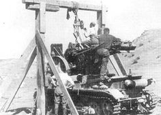 A wooden frame and winch system was used to load the 15 cm s.I.G 33 gun onto the tank chassis