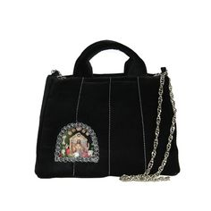 """Crossbody bag """"Little Black Saint"""" with chain This handmade retro purse is firmly reinforced and suitable for every occasion. The pink lining is sewn from hand-printed satin. One inside pocket. Silver chain shoulder strap.  A window with an original motif in the style of a shrine with shells, little hands and flowers is protected by a solid film. You can use fixed ear handbags to hold in your hand or the chain to wear it as a crossbody bag over your shoulder. Zip fastening with a silver cross. Fashion Brand, New Fashion, Handmade Handbags, You Bag, Timeless Design, Crossbody Bags, Shoulder Strap, Shells, Window"""